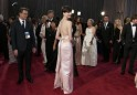 "Best Supporting Actress Nominee Hathaway for her role in ""Les Miserables,"" arrives wearing a Prada light pink duchesse satin backless column gown at the 85th Academy Awards in Hollywood"