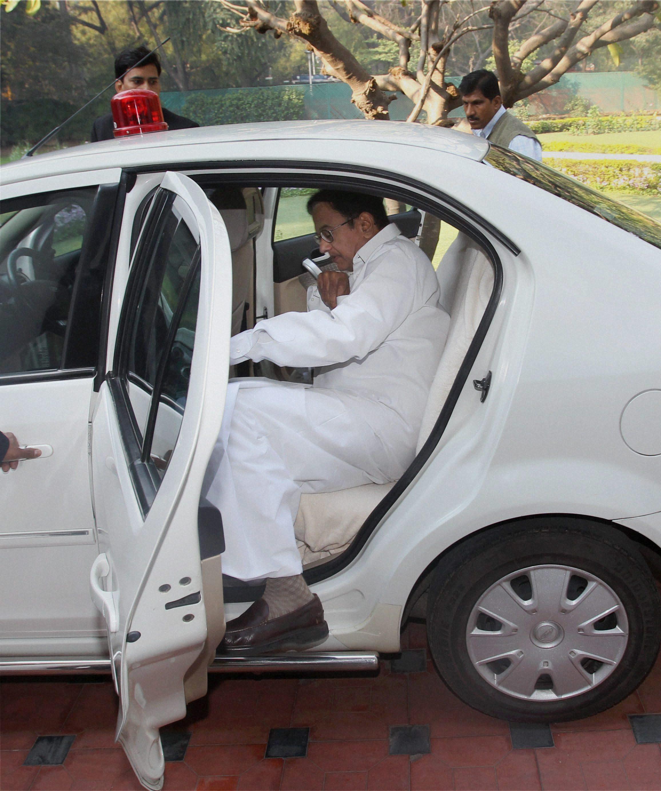 Chidambaram gets into the car.
