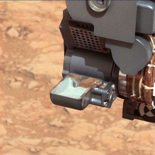 First sample of powdered rock obtained from planet Mars.