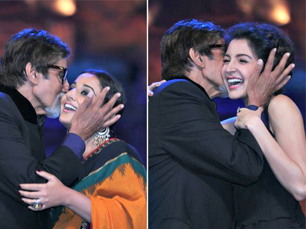 Amitabh Bachchan kisses Vidya Balan & Anushka Sharma: The doting grandpa towered over his younger co-stars and showed that he is still up for some good-natured mischief at the Stardust Awards.