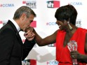 George Clooney kisses Viola Davis