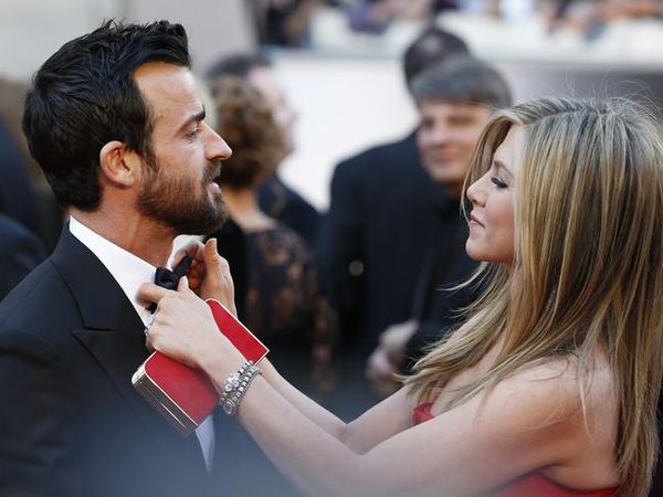 Jennifer Aniston and Justin Theroux arrive at the 85th Academy Awards in Hollywood.
