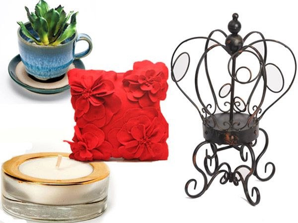 Accessorise with functional and decorative extras by Houseproud. Their Crown Wine Rack, Lily Red Cushion, Scented Tealights, and Teacup Planter with Saucer will add character and dimension to your space.