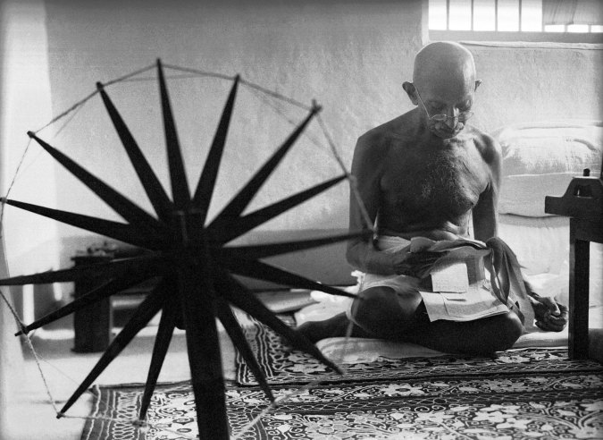 Mahatma Gandhi behind the spinning wheel in 1946. (photo: getty images)