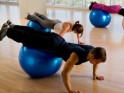1 Leg Raise: Prone over Stability Ball