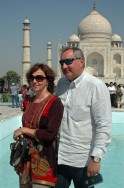 Russia's DPM Rogozin and his wife Tatiana pose in front of the historic Taj Mahal in the northern Indian city of Agra