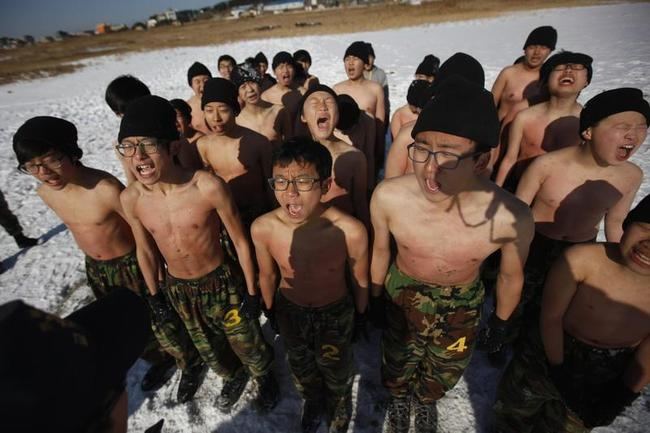 Students react while attending a winter military camp in Ansan