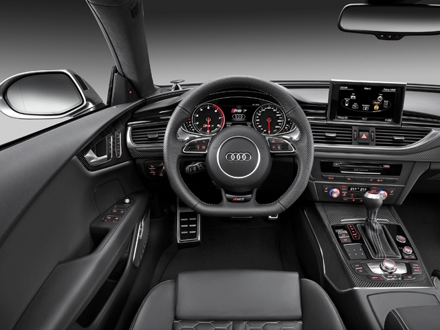 The key, the flat-bottomed, three-spoke leather steering wheel, the illuminated door entry sills and the displays for the MMI and driver information system also sport RS badges