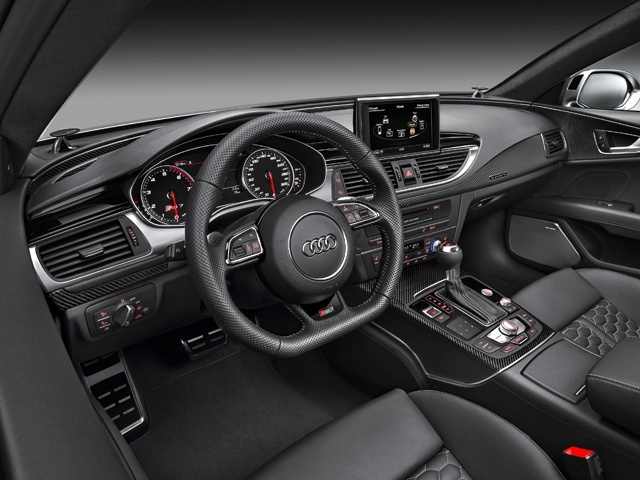The dial instruments have black faces, white scales and red needles. A 3D RS 7 logo in the tachometer is a further accent