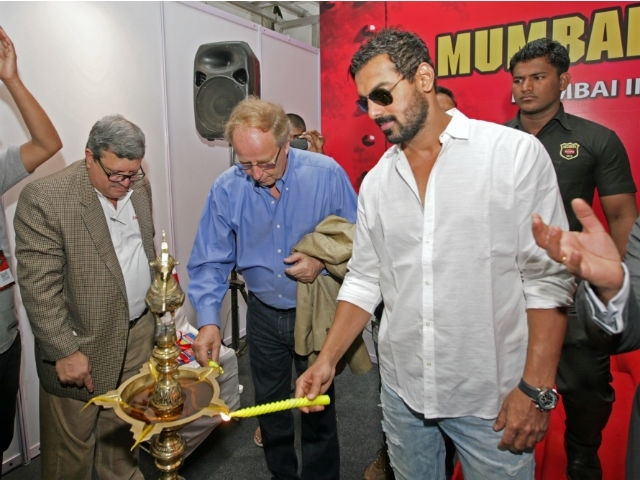 Bollywood actor John Abraham and World Rally Car Champion Hannu Mikkola along with Editor in Chief Adil light the inauguration lamp at the Mumbai International Motor Show 2013