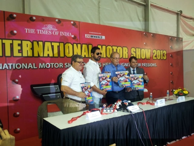 Bollywood actor John Abraham and World Rally Car Champion Hannu Mikkola along with Editor in Chief Adil present the ZigWheels MIMS special magazine at the Mumbai International MotorShow 2013
