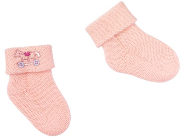 Pretty in Pink: These socks, from Hermes' Adada collection, are made from cashmere and come embroidered with rocking horses. Available at Hermes in Mumbai, Delhi & Pune.