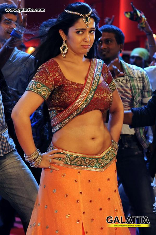 Charmi in a still from an item song in Naayak