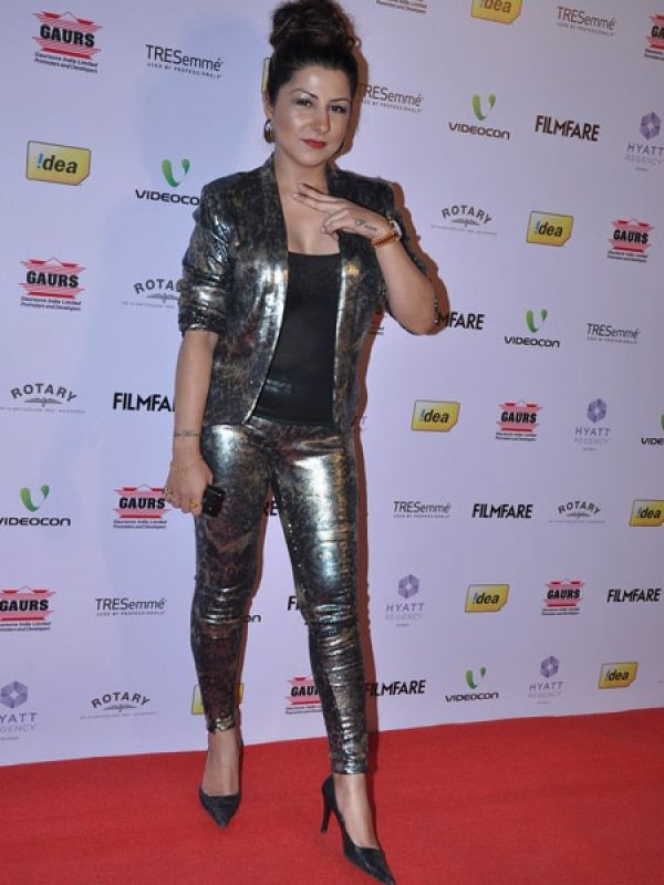 We don't expect too much from Hard Kaur when it comes to dressing, but this shiny suit took atrocious to a whole new level.