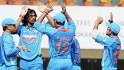 India's Ishant Sharma celebrates with teammates after dismissing England batsman KP Pietersen during the 3rd ODI cricket match at JSCA Stadium in Ranchi on Saturday