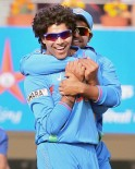 India's R Jadeja celebrates with Suresh Raina after dismissing England batsman JW Dernbatch