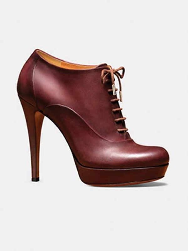 Burgundy lace-up booties by Gucci.
