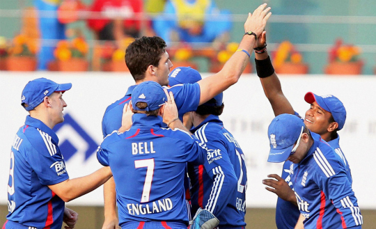 England bowler Steven Finn celebrates with teammates after dismissing Indian batsman A. Rahane