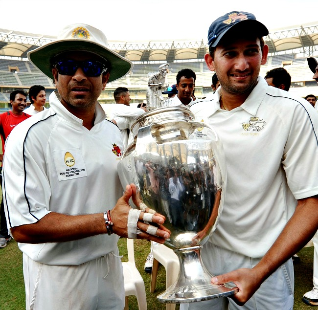 Sachin Tendulkar and Ajit Agarkar pose with the majestic Ranji Trophy. (Photo: BCCL)