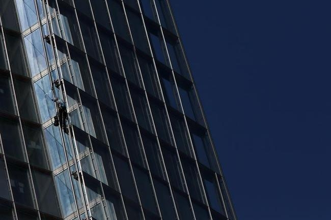 A Greenpeace demonstrator climbs the Shard building, in central London