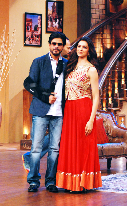 Shah Rukh Khan and Deepika Padukone during the promotion of their upcoming film, Chennai Express, on the sets of TV show, Comedy Nights With Kapil, in Mumbai, on 1st July.