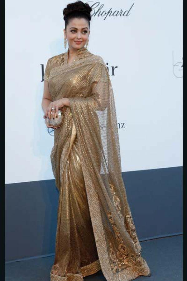 Aishwarya resonated AmFAR's theme in a golden sari created by Tarun Tahiliani.