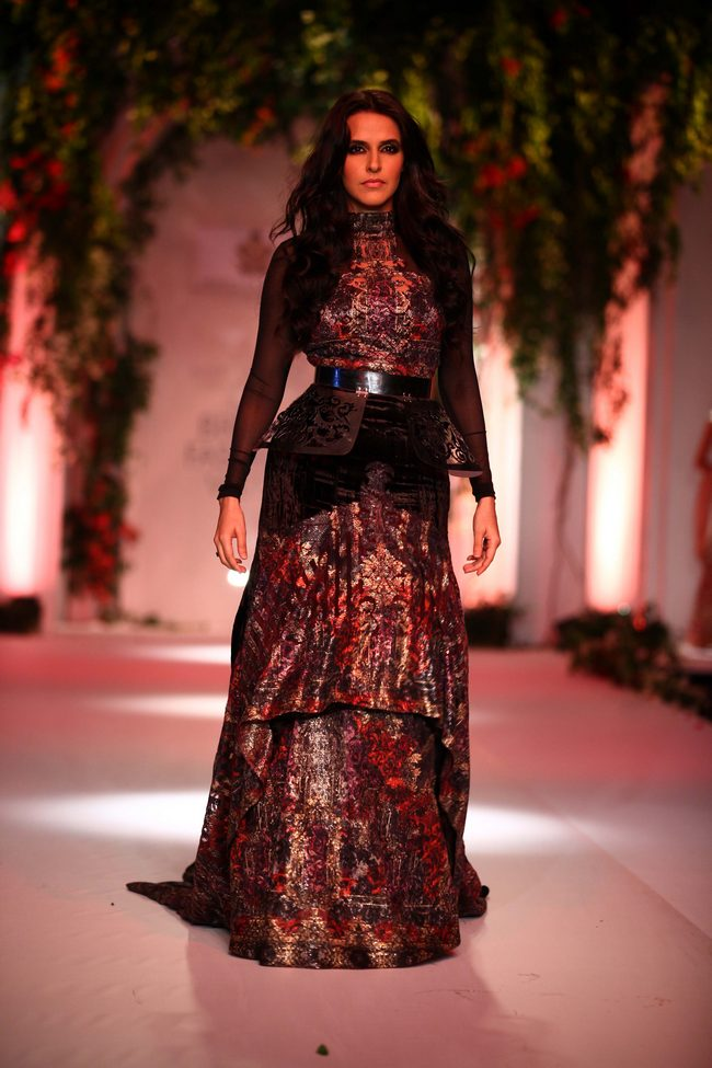 Neha Dhupia walked the ramp for designers Falguni & Shane Peacock at the Aamby Valley Bridal Fashion Week.