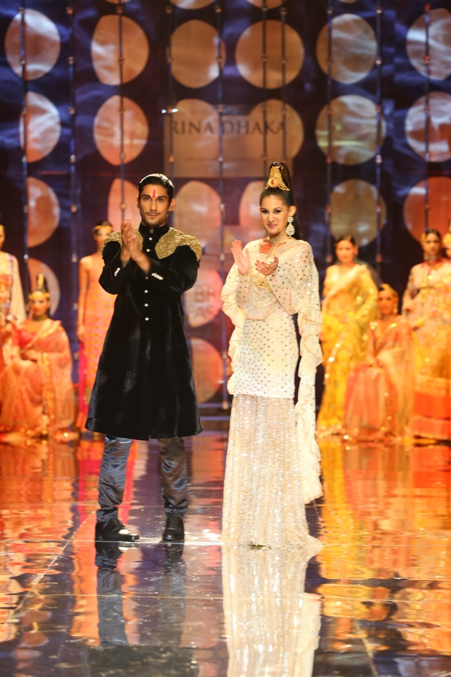 'Issaq' stars, Prateik Babbar and Amyra Dastur walked the ramp for designer Rina Dhaka at the Aamby Valley Bridal Fashion Week.