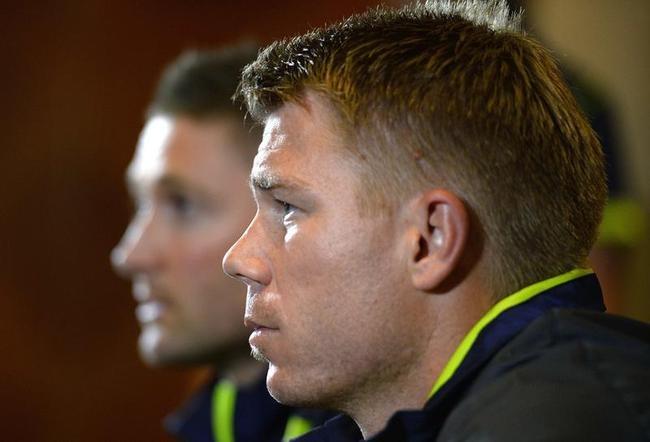 Australian cricket captain Michael Clarke and David Warner speak to the media in London