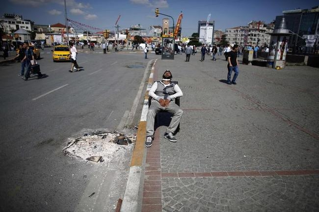 A protester sleeps on a chair at Taksim Square in central Istanbul