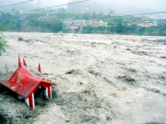 A temple submerged in flooded river Ganga due to heavy rains in Uttarkashi on Sunday. Thousands of Char Dham pilgrims were stranded on Gangotri and Yamunotri routes, as incessant overnight showers across Uttarakhand caused landslips in Uttarkashi district and swelled rivers.