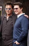 Actors Johnny Depp and Tom Cruise pose during ceremonies for  film and television producer Jerry Bruckheimer honoring Bruckheimer with a star on the Hollywood Walk of Fame in Hollywood