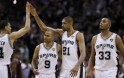 San Antonio Spurs' Duncan celebrates with teammates Green, Parker and Diaw during the fourth quarter in Game 5 of their NBA Finals basketball series in San Antonio