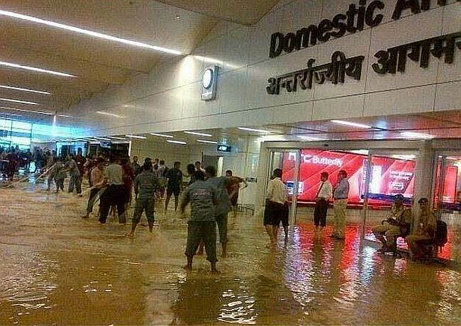 Incessant heavy rains led to water-logging at the Indira Gandhi Airport (IGI) airport in New Delhi.Image Courtesy: Twitter, @shukla_tarun