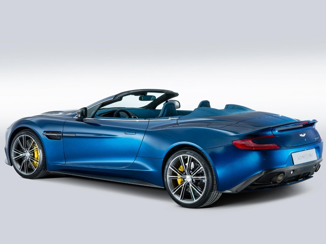 The design of Vanquish Volante represents the latest take on Aston Martin's iconic visual language. Styling cues such as the elegant waist, elongated side strakes and LED rear light blades are derived from the One-77 supercar while the folding fabric roof sits beneath a tonneau and decklid that have been aerodynamically tuned for optimum performance