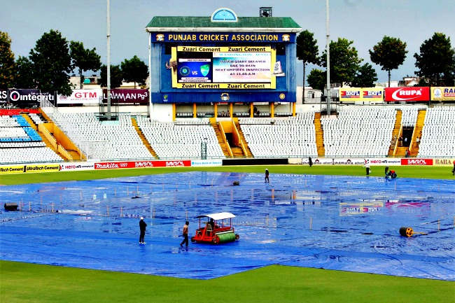 Groundsmen clear the pitch for the 3rd Test between Indian and Australia at PCA Stadium in Mohali on Thursday. (Photo: PTI)