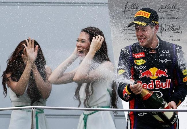 Sebastian Vettel with Grid Girls