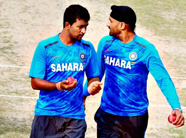Pragyan Ojha and Harbhajan Singh