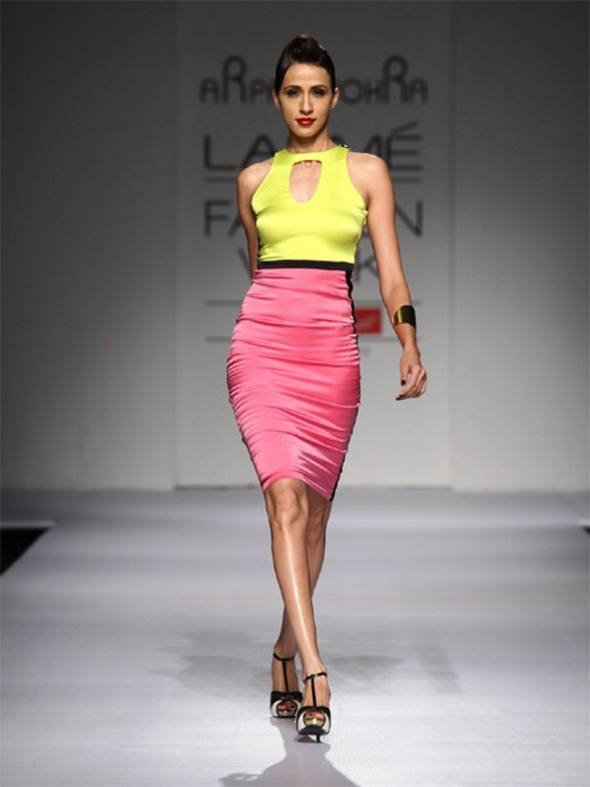 Flaunt your figure in this pencil colour block dress in yellow and pretty pink by designer Arpan Vohra.
