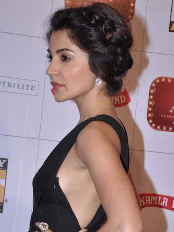 Anushka Sharma: A messy bun looks trendy and allows your neck to breathe in summer.