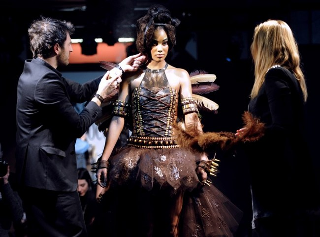 Fashion designers work on a dress made from chocolate during the second Bordeaux's Chocolate fair (Salon du Chocolat) on March 15, 2013, in Bordeaux, western France.