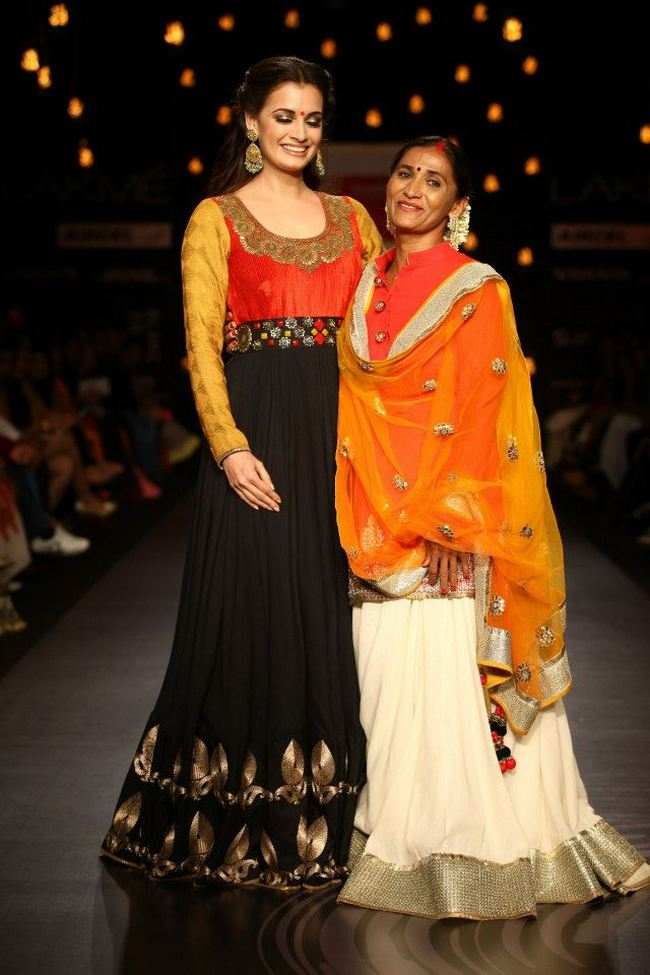 Dia Mirza walked for designer Vikram Phadnis at Lakme Fashion Week 2013.