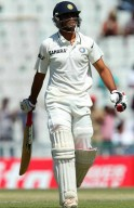Jadeja walks back after being dismissed by Peter Siddle