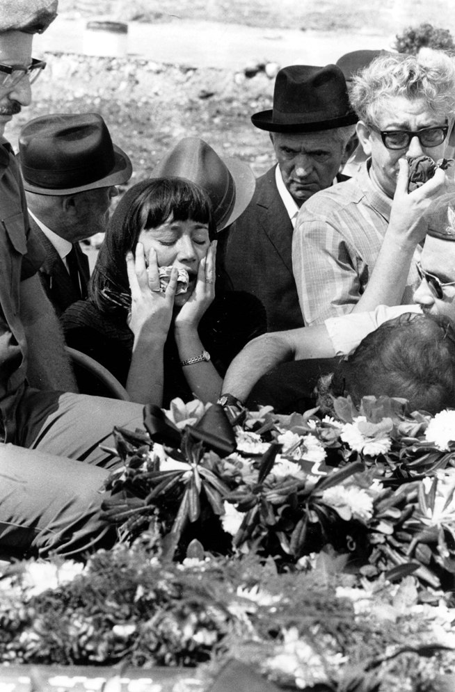 During the Munich Games, Palestinian militant outfit Black September took the Israeli national team hostage on September 5, 1972, eventually slaughtering eleven athletes and coaches and one German police officer after a 16-hour ordeal. For the first time in modern Olympic history, competition was suspended for a memorial service held in the Olympic Stadium attended by 80,000 spectators and 3,000 athletes. (Photo: Getty Images)