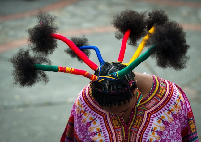 A woman presents an Afro-Colombian hairstyle during the 9th contest of Afro-hairdressers, in Cali, Valle del Cauca departament, Colombia, on May 12, 2013. The Afro hairstyles have their origins in the time of slavery, when women sat to comb their children hair after work.