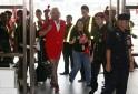 British entrepreneur Branson, wearing an AirAsia stewardess uniform, arrives during an AirAsia promotional event at an airport in Sepang
