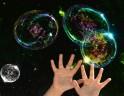 Children Reach for Big Bubbles in Kiev