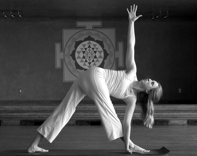 Back Pain: 20 Yoga Poses for Backache : Parivrtta trikonasana (revolved triangle pose)