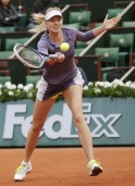 Sharapova of Russia hits a return to Bouchard of Canada during their women's singles match at the French Open tennis tournament in Paris