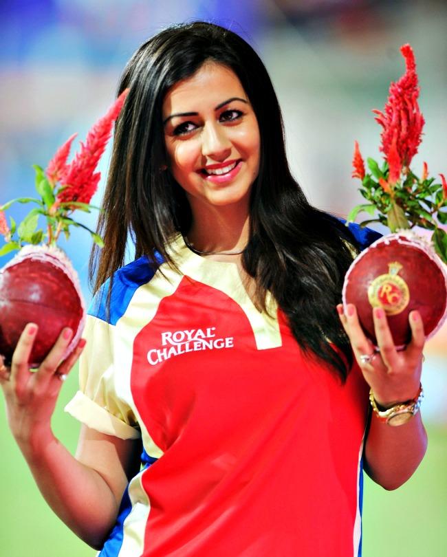 April 20, 2013: Actress Nikki Galrani during an IPL match at the Chinnaswamy Stadium in Bangalore. (Photo: BCCL)